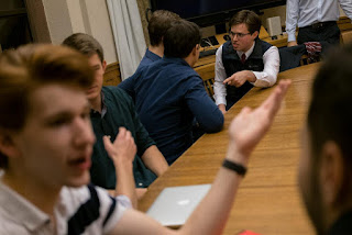 Alexander Posner, right, at a meeting of Students for Carbon Dividends at Yale University. The group pulls together millennial-aged conservatives to promote acceptance of climate change and propose conservative solutions. (Credit: Christopher Lee for The New York Times) Click to Enlarge.