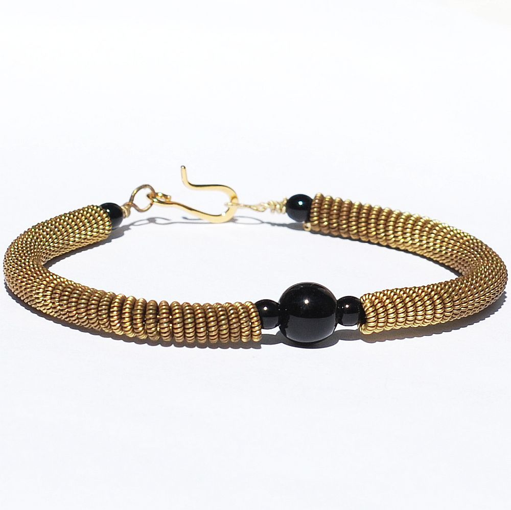 guitar string jewelry by tanith rohe guitar string bracelet black and brass. Black Bedroom Furniture Sets. Home Design Ideas
