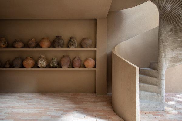 ceramic vases on shelves stairs