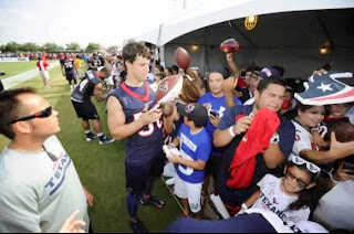 Intern Ethan Martinez keeps an eye on fans at the Houston Texans Training Camp.