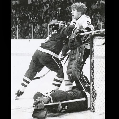 It only looks like... goalie Gary Smith is trying to perform a skate-blade appendectomy on Terry O'Reilly - oh wait, he is