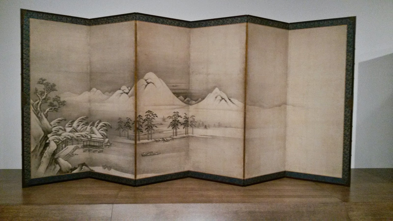 Japanese Edo screen showing landscape with small boat