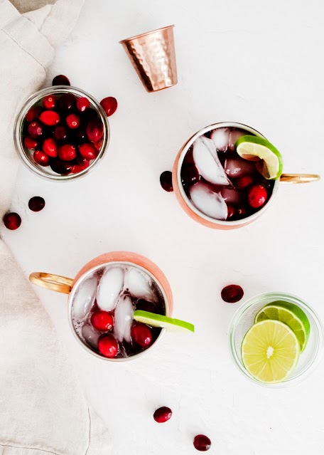 Cranberry Moscow Mule from above with cranberries and lime slices