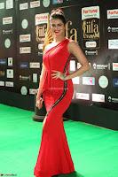 Meenakshi Dixit in Red One Shoulder Red Zipped up gown at IIFA Utsavam Award 80.JPG