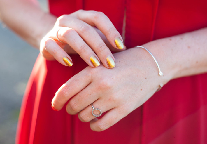 gold nailpolish, silver jewelry
