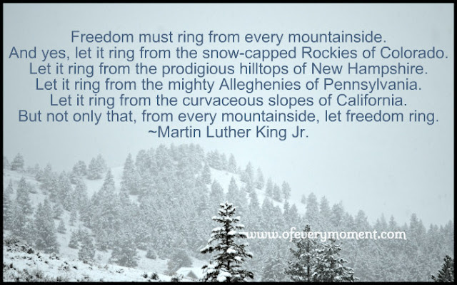 Martin Luther King Jr quote about freedom typed on a mountain scene