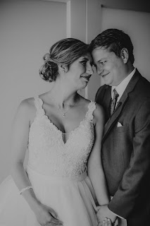 Candid romantic photo of bride and groom