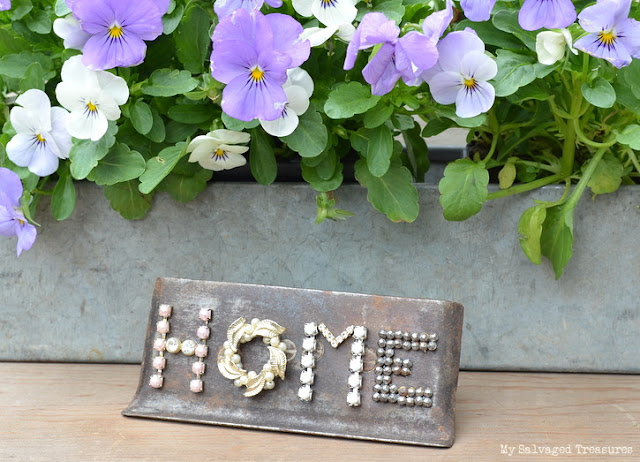 use vintage jewels to create a unique sign with an old concrete tool