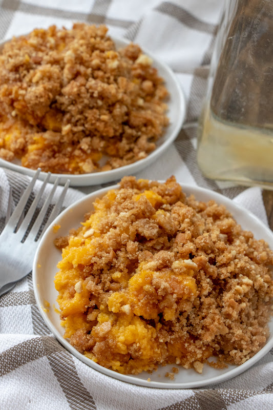 A delicious, sweet butternut squash casserole that's a holiday family favorite dessert! The crunchy topping is to die for and it makes enough to feed the whole family at Thanksgiving or Christmas!
