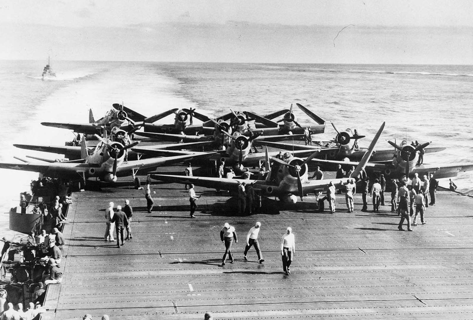 TBD-1 torpedo bombers of Torpedo Squadron Six unfold their wings on the deck of USS Enterprise prior to launching an attack against four Japanese carriers on the first day of the Battle of Midway. Launched on the morning of June 4, 1942, against the Japanese carrier fleet during the Battle of Midway, the squadron lost ten of fourteen aircraft during their attack.