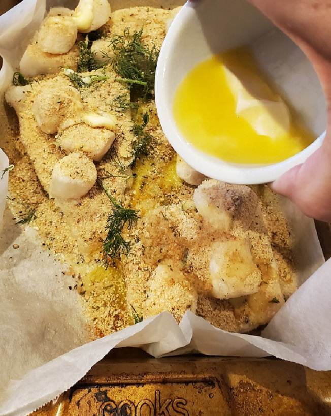 this is a pan of scallops and haddock with breadcrumbs and a lemon butter sauce on top