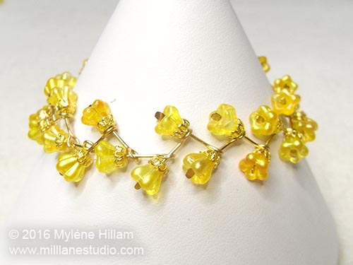 Cheery yellow flower beads are arranged in a zigzag pattern in this bracelet.