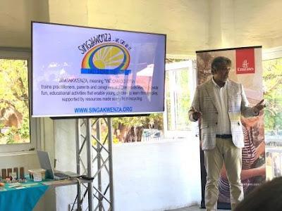 Fouad Caunhye, Emirates Regional Manager, Southern Africa in front of Singakwenza NGO pwpt