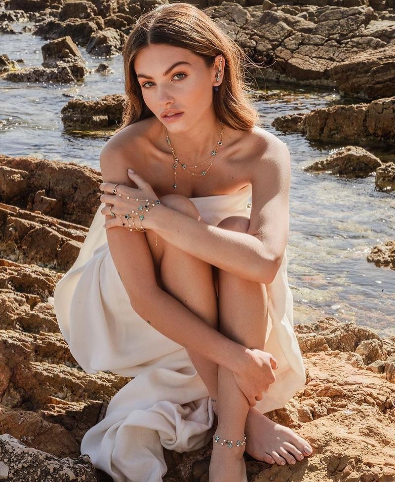 Posing on the beach sand, Thylane Blondeau wears APM Monaco ROMA collection.