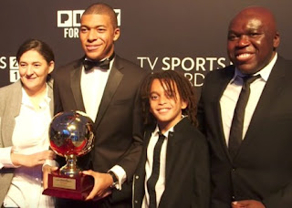Wilfried Mbappe with his wife Fayza & their sons