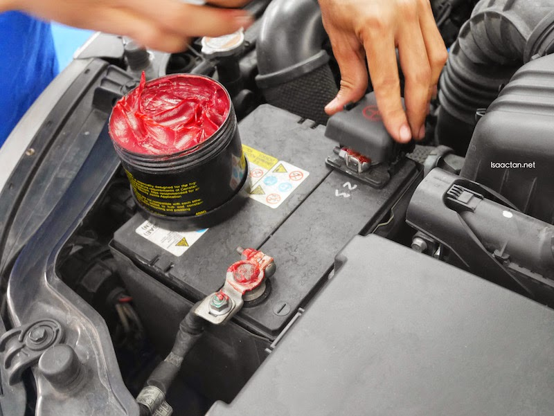 Grease application on the car battery connectors