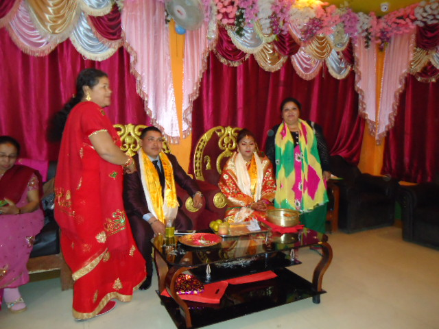 Lear and scott mission in nepal nepali wedding reception and darray the reception line is different here the bride and groom sit on a raised platform in very fancy chairs as guests arrive they put silk scarves on the bride junglespirit Image collections