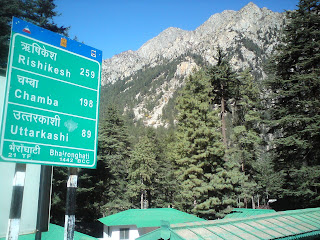 A board showing important road distances from Bhaironghati in the Garhwal Himalyas