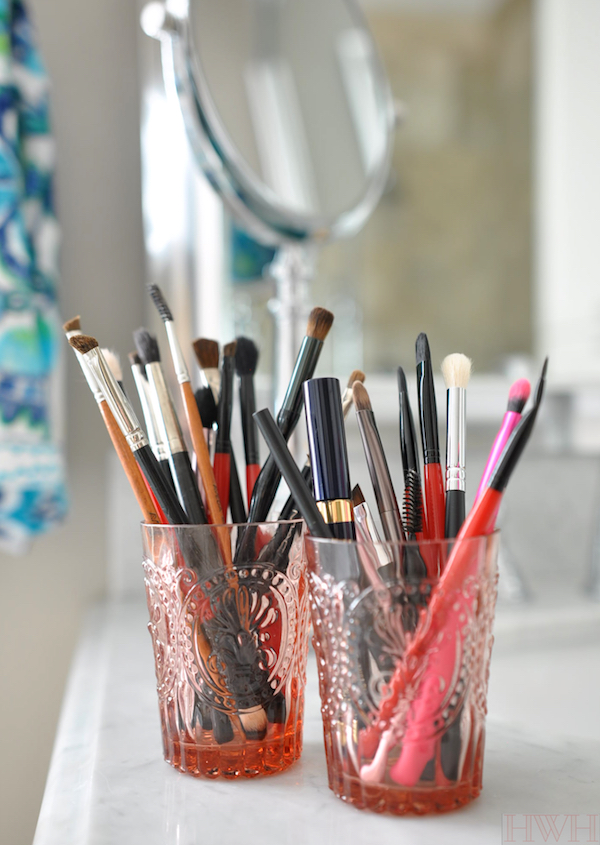 Clean makeup brushes stored upright in cute little glasses, easy to see and reach for what you need and keeps the bristles from getting mangled in a drawer