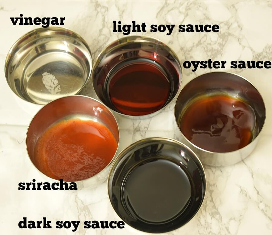 ingredients to make the sauce for chicken fried rice - vinegar,light soy sauce,dark soy sauce,oyster sauce,sriracha,sugar