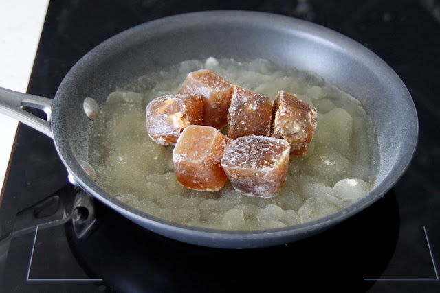 Preparing gelatin and homemade stock in a pan for gummy dog treats