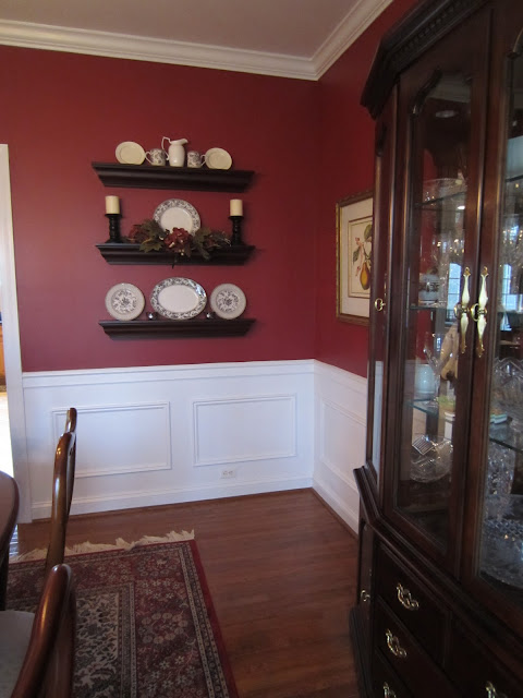 Wall Shelves in Red Dining Room - decorated for fall