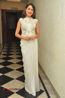 Actress Pragya Jaiswal Stills in Beautiful White Dress at turodu Audio Launch  0045.JPG