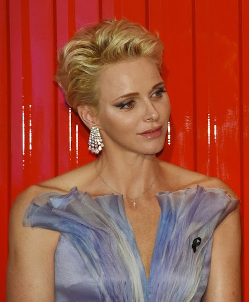 Prince Albert and Princess Charlene attended the 68th annual Monaco Red Cross Gala, Charlene wore Velentino Gown dress, Cartier Diamond Earrings