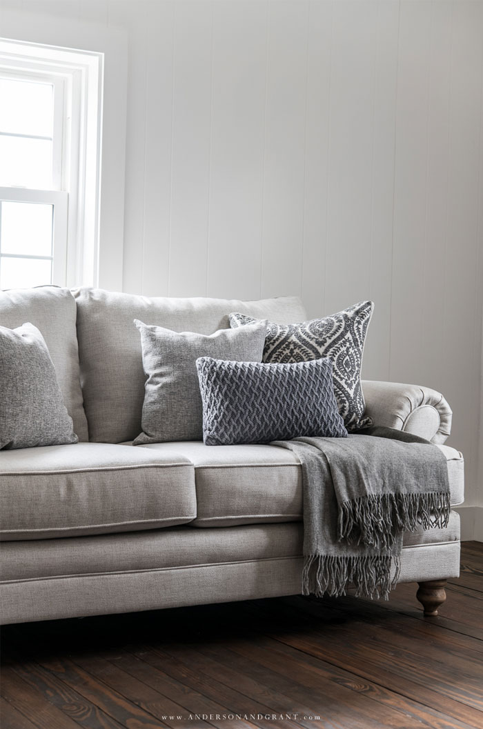 Neutral sofa in white room