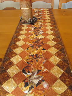 https://www.patchworkmountain.com/collections/table-runners/products/fall-leaves-table-runner-1