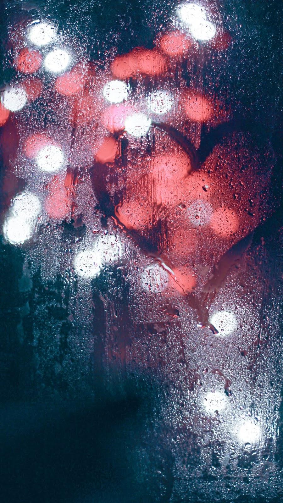 Heart shape on window glass mobile wallpaper