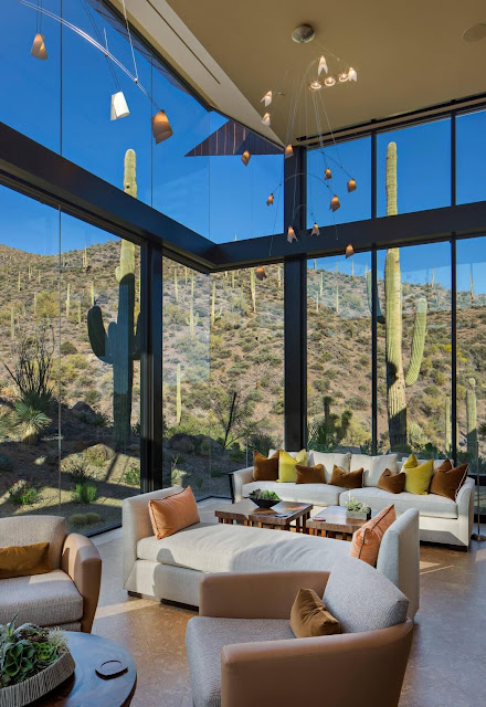 Two-story sitting room with a panoramic view of the Saguaro Forest in Arizona.