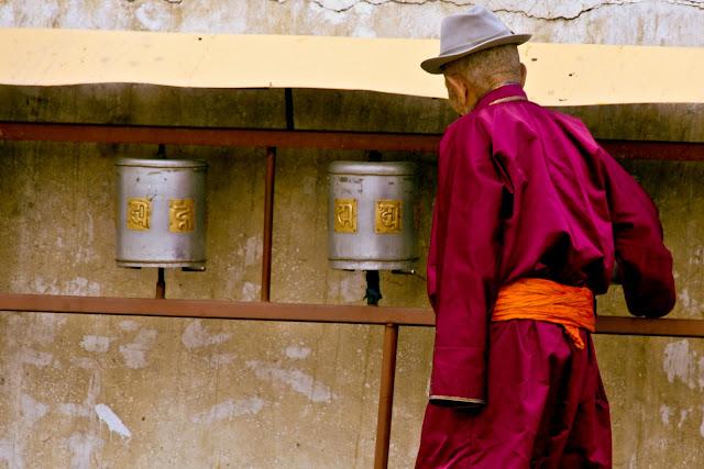 Prayer wheels with Tibetan script inlaid upon them. Gandan Monastery, Ulaanbaatar