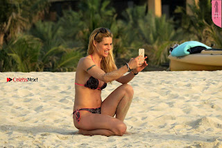 Michelle Hunziker taking selfie in bikini on beach in dubai April 2017
