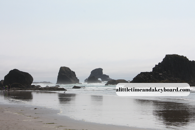 Rocks and an arch lining the Oregon Coast at Ecola State Park.