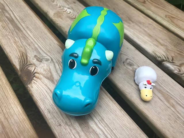 dragon toy on garden bench
