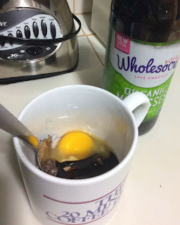 mug with molasses; ingredients in mug