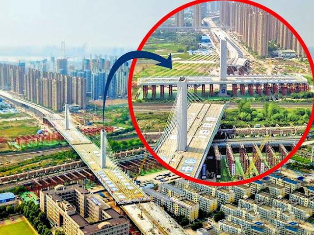 रेलवे ट्रैक बनाने के लिए केबल ब्रिज का 248 मीटर लंबा और 18 टन वजनी हिस्सा घुमाया