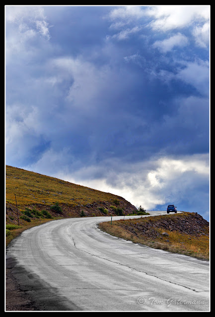 A Lone Car Drives Up Mount Evans Road on Mount Evans.