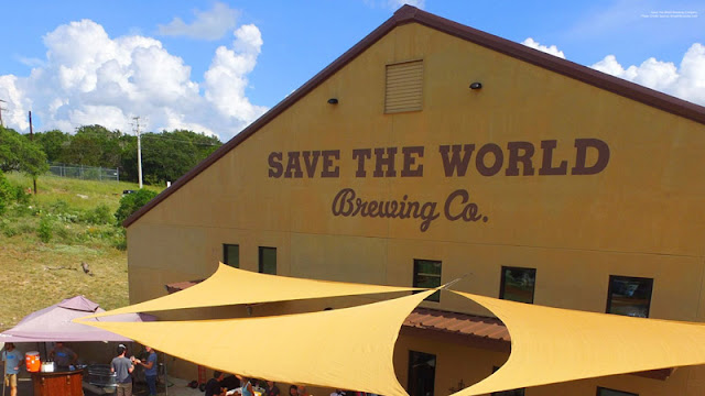 the yellow exterior and coverings of Save The World Brewing Co