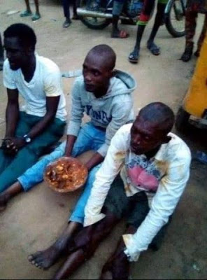 f2 - three males carrying sacrifice in Ikorodu, pressured to eat it [photos]