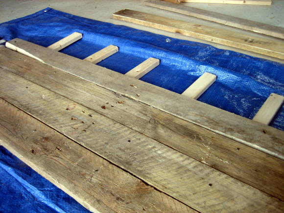 Step four: start nailing the support beams to your pallet wood.