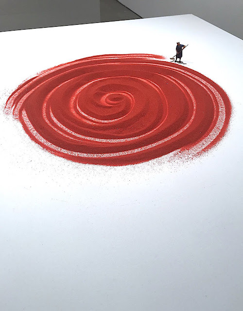 Liliana Porter 2018 art, a woman cleaning a giant red spiral