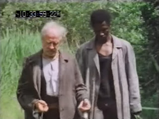 Adler (Cyril Cusack) and Boysie (Willie Jonah) gather herbs in The Mind Beyond: The Man With the Power