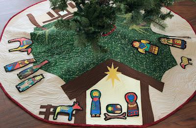 http://www.buttonsandbutterflies.com/2015/11/nativity-tree-skirt-school-auction.html