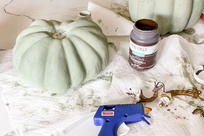Gluing stems onto faux pumpkins