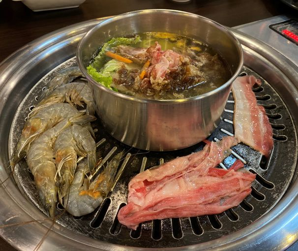 Shrimp, meat, and beef bulgogi soup on the grill at All4U Unlimited Grill & Shabu Shabu