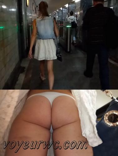 Upskirts 4238-4247 (Secretly taking an upskirt video of beautiful women on escalator)