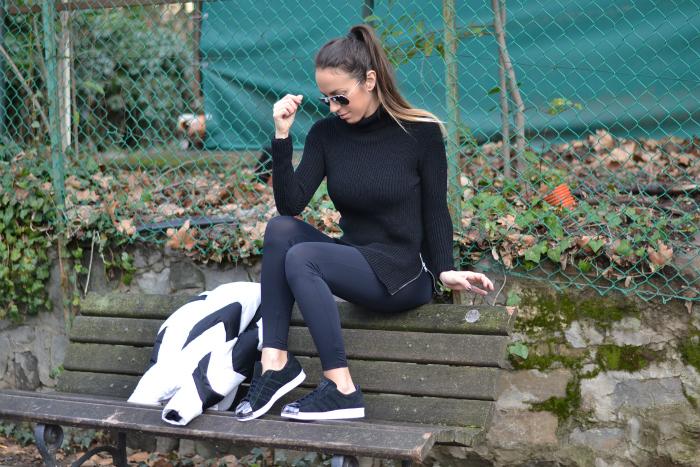 maglione nero con zip