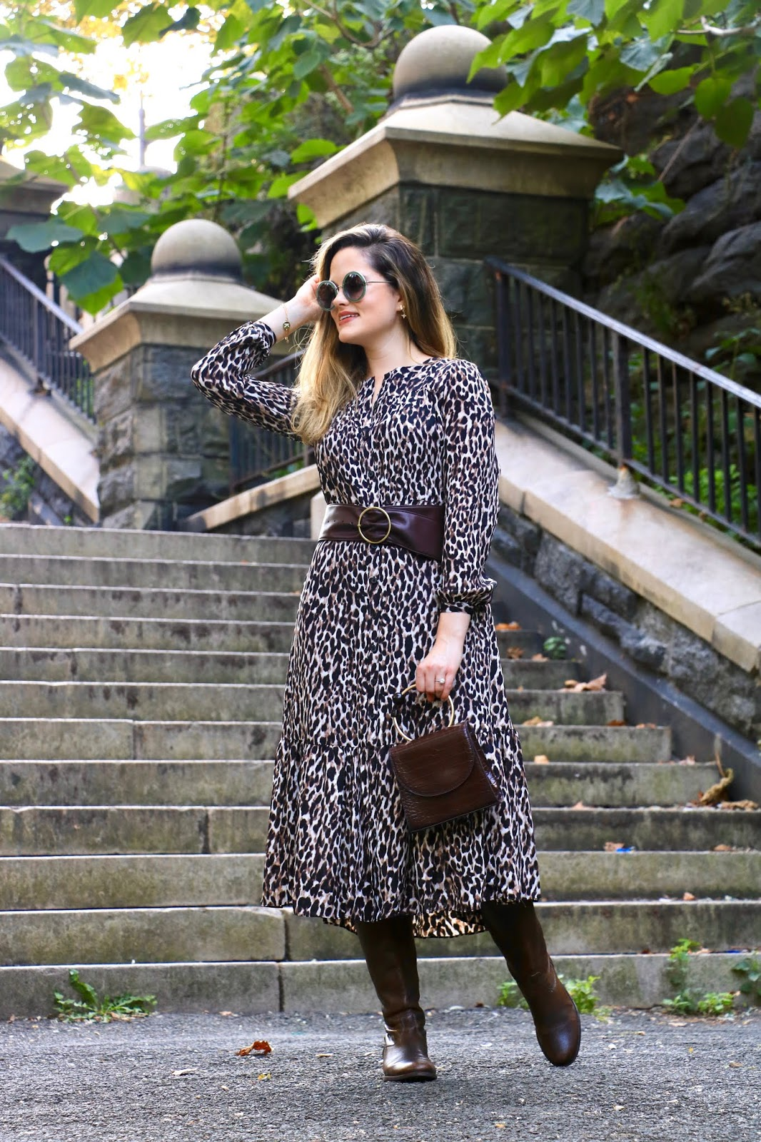 Nyc fashion blogger Kathleen Harper wearing a leopard midi dress.